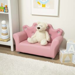Crown shaped pink faux leather sofa with white teddy bear