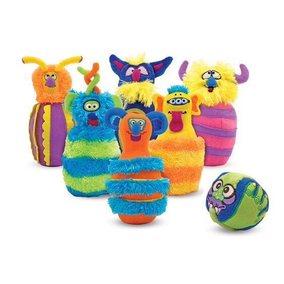 Six plush monster themed bowling pins and a plush monster themed bowling ball