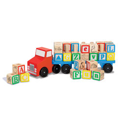 Wooden truck with alphabet blocks stacked on back