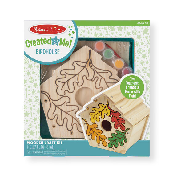 Wooden birdhouse and decoration materials in packaging