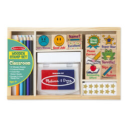 Wooden case with classroom themed wooden stamps, colored pencils, sticker pad, and a stamp pad in packaging