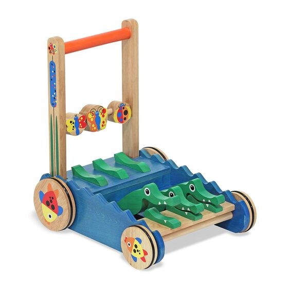 Rolling push toy with three alligator figures