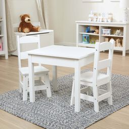 Two White chairs and table in play room