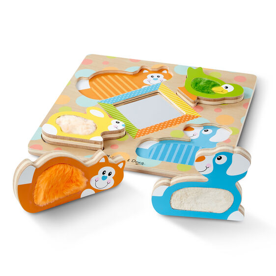 Four piece puzzle with mirror in the middle and fuzzy wooden pieces of kitten, puppy, bunny, and bird