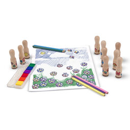 Various wooden stamps, colored pencils, coloring pad, and multi-colored stamp pad