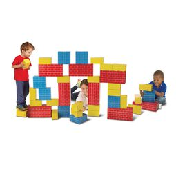 Three children playing with colorful jumbo cardboard blocks