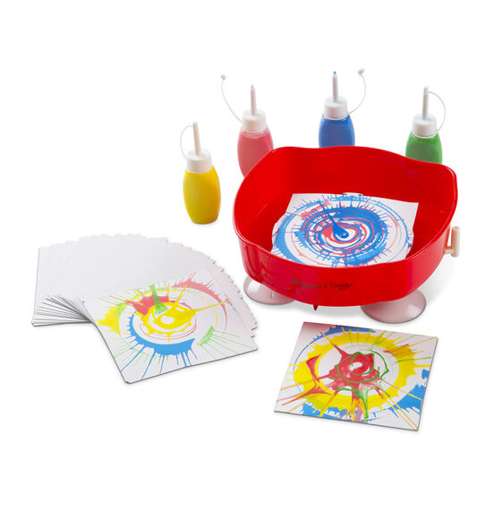 Design cards, paint tubes, and red art spinner with suction cup base