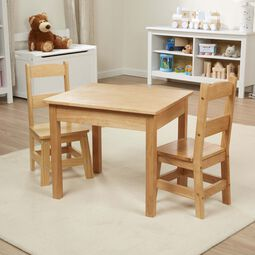 Wooden table with two chairs in playroom
