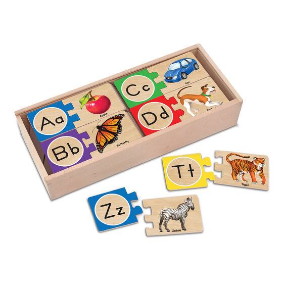 Wooden box full of two piece alphabet puzzles