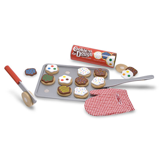 Wooden cookies and tray with a knife, spatula, oven mit, and cookie dough sleeve