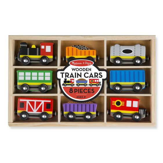 Wooden train cars in packaging