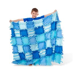 Boy holding striped fleece quilt