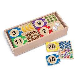 Wooden box full of two piece number puzzles