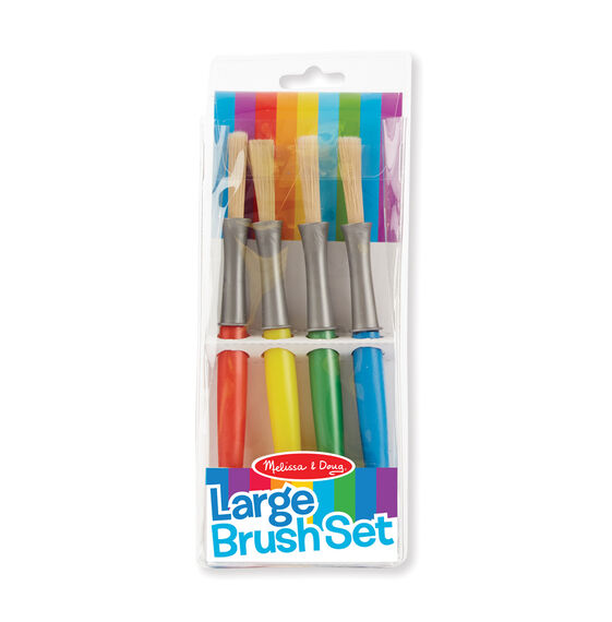 Four large colored paint brushes in packaging
