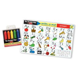 five multi-colored crayons in packaging next to alphabet learning mat