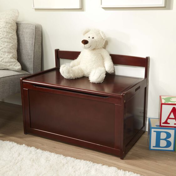 Brown toy chest with white teddy bear on top