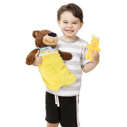 Teddy bear in sleeping bag and yellow bunny
