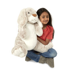 Girl hugging burrow bunny stuffed animal
