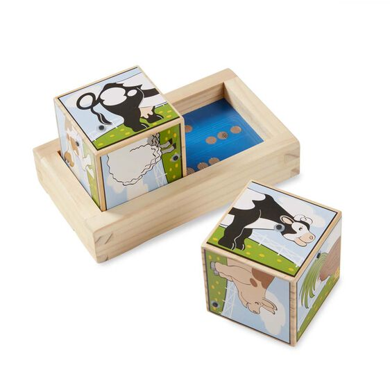 One wooden block with rears of farm animals in wooden frame with second wooden block, displaying fronts of animals, outside of frame