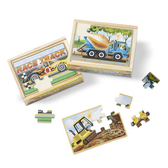 Fire engine jigsaw puzzle with puzzle pieces in wooden box