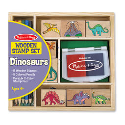 Wooden case with wooden dinosaur stamps, a stamp pad, and colored pencils in packaging