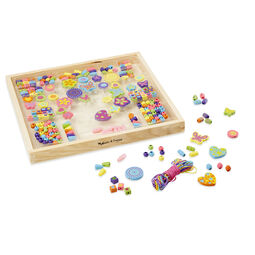 Various beads and strings in wooden case