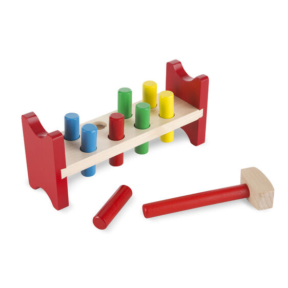 Wooden bench with pounding pegs and wooden mallet