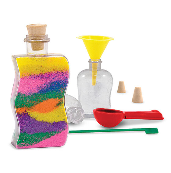Corked bottle filled with sand, Two additional plastic bottles, sand funnel, design tool, and sand scoop