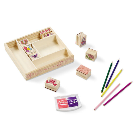 Wooden case with various wooden stamps, a stamp pad, and colored pencils