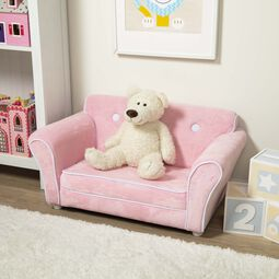 Pink plush sofa with white teddy bear