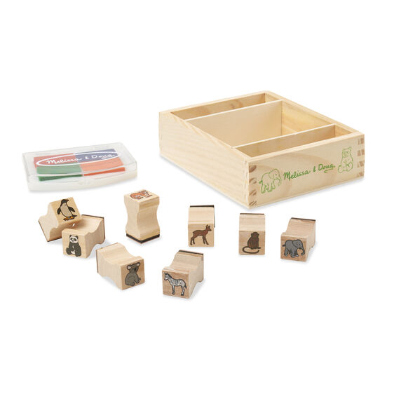Wooden baby animal stamps and stamp pad outside of wooden case