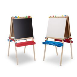 Two easels standing next to each other with one showing chalk board side and the other showing whiteboard side