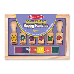 Six wooden stamps and colored stamp pad in wooden case in packaging