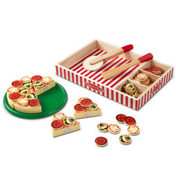 Wooden pizza with toppings, tray, pizza cutter, and wooden case