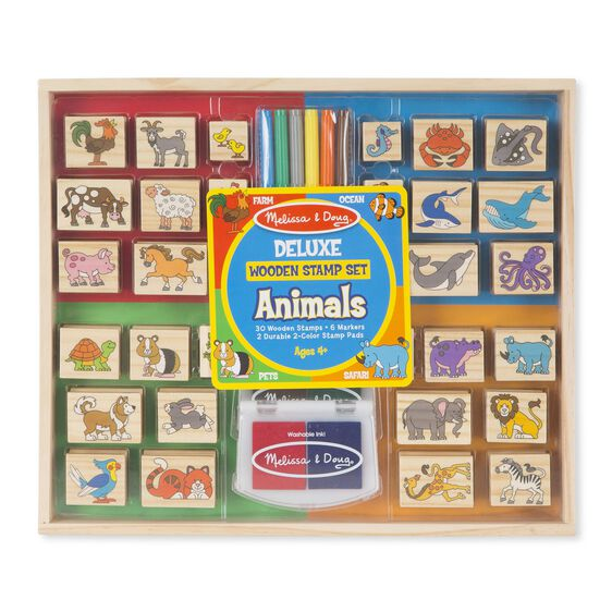 Animal themed wooden stamps with colored markers and stamp pad in packaging