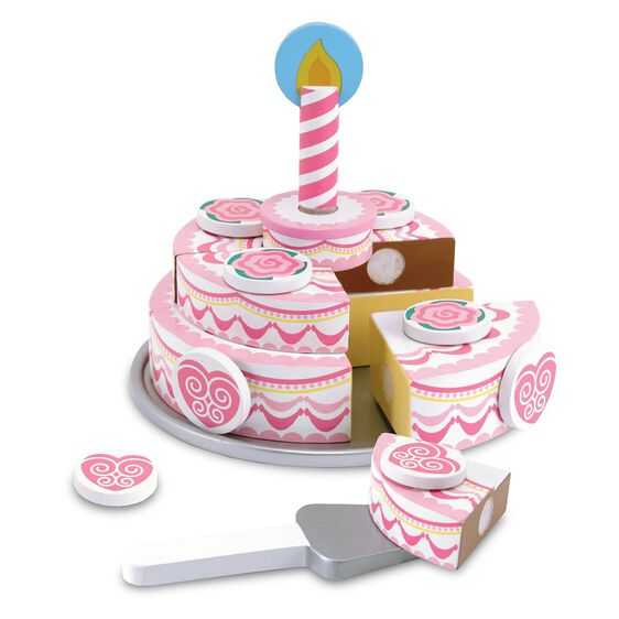 Pink three layer party cake with a candle and a spatula
