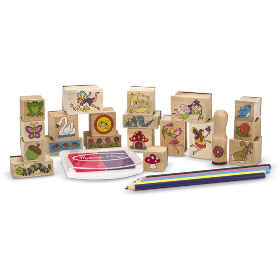 Fairy garden themed wooden stamps, colored pencils, and stamp pad