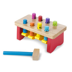 Wooden mallet and bench with wooden pounding pegs