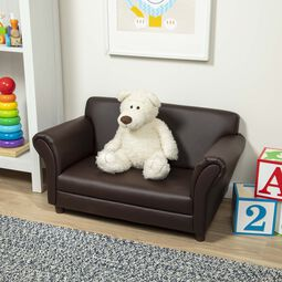 Brown faux leather sofa with white teddy bear