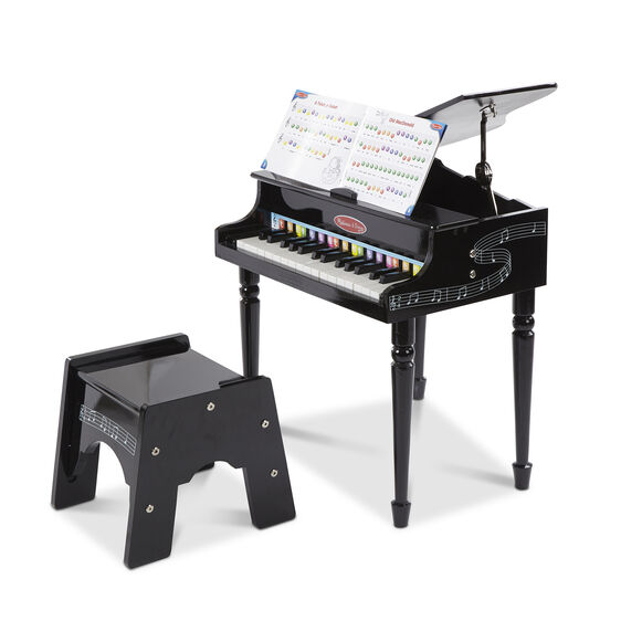 Black miniature grand piano with music book and stool