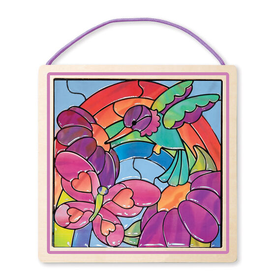 Decorated stained glass window with bird and butterfly