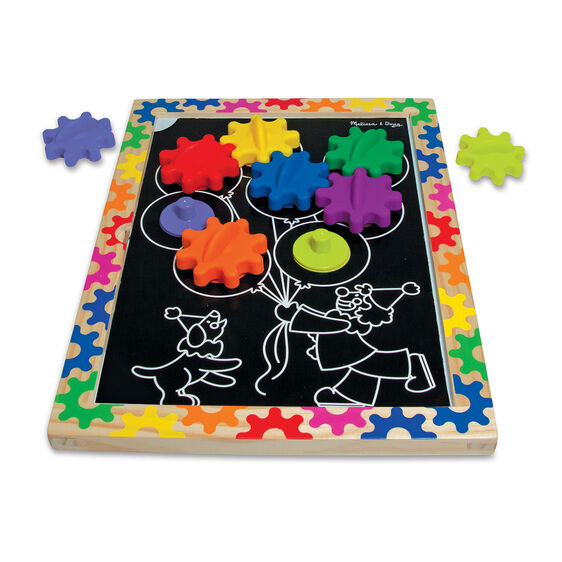 Black magnetic board with spinning gears