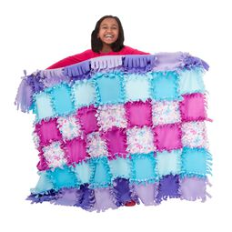 Girl holding butterfly fleece quilt